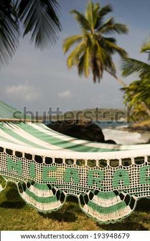hammock with palm coconut trees on Caribbean Sea at Casa-Canada resort Corn Island Nicaragua Central America   - stock photo