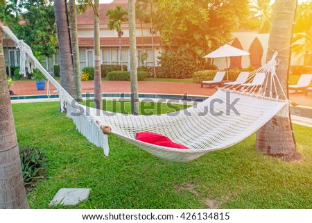 hammocks in Luxury swimming pool for relaxation. - stock photo