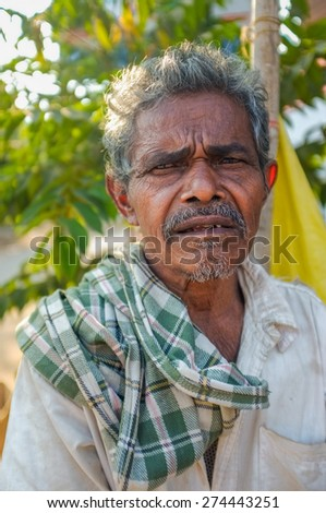 HAMPI, INDIA - 31 JANUARY 2015: Indian elderly man with checked scarf