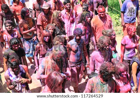 HAMPI - MARCH 9: Unidentified people celebrate Holi festival in Hampi, India on March 9, 2012. It's a religious spring holiday and also known as Festival of Colours. - stock photo