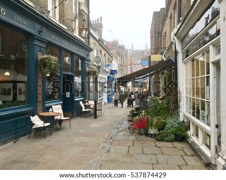 HAMPSTEAD, LONDON - DECEMBER 17: The urban village atmosphere amongst the Pubs and Shops along Flask Walk on December 17, 2016 in Hampstead, London, UK.