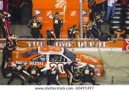HAMPTON, GA - SEP 05:  Joey Logano brings his Home Depot Toyota in for service during the Emory Healthcare 500 race at the Atlanta Motor Speedway in Hampton, GA on Sep 05, 2010. - stock photo