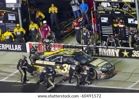 HAMPTON, GA - SEP 05:  Ryan Newman brings his US Army Chevrolet in for service during the Emory Healthcare 500 race at the Atlanta Motor Speedway in Hampton, GA on Sep 05, 2010. - stock photo