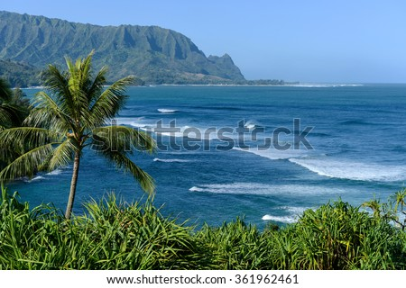 Hanalei Bay - Strong blue waves in the Hanalei bay on the north shore of Kauai, Hawaii, USA. - stock photo