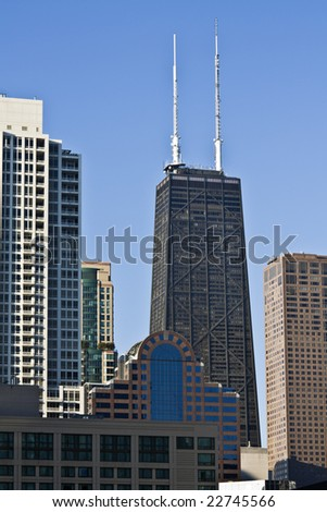 Hancock between other buildings - Chicago, IL. - stock photo