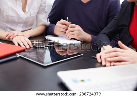 hand a group of businessmen on a table with a tablet, mobile phone