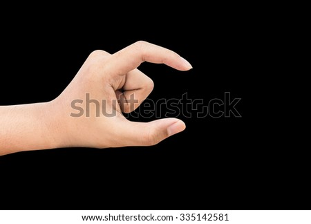 Hand acting on black background - stock photo