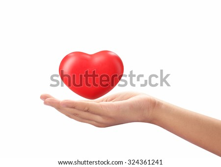 Hand acting with red heart isolated on white background with clipping path.