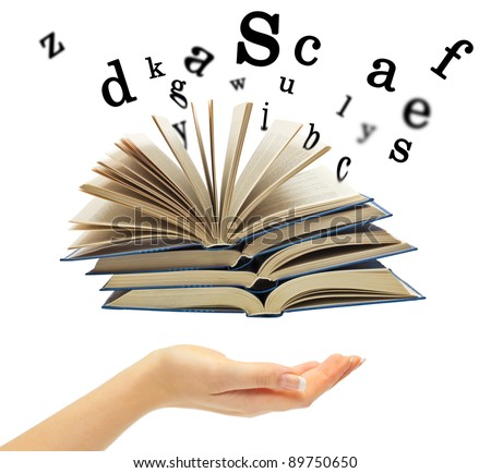 Hand and a book with departing letters on a white background - stock photo