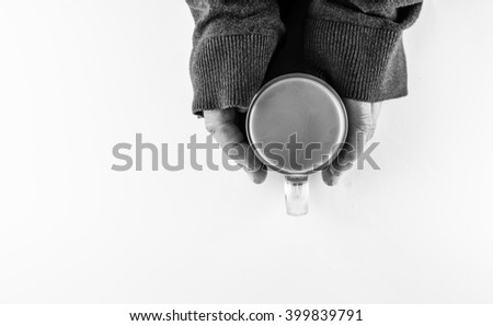 hand and a cup of coffee - stock photo