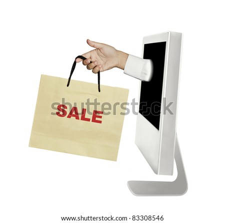 hand and bag out of the computer - stock photo