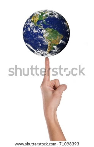 Hand and balance world over white background. - stock photo