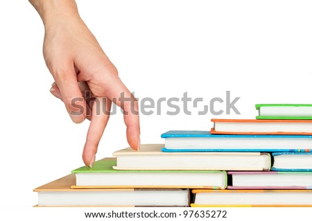 Hand and book stairs isolated on white background - stock photo
