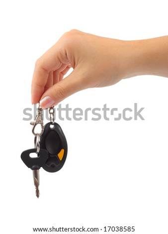 Hand and car key isolated on white background - stock photo