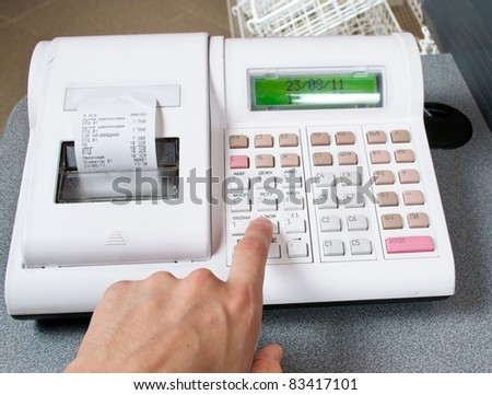 hand and cash register - stock photo
