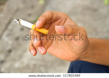 Hand and cigarette
