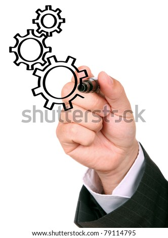 Hand and cogwheels - stock photo