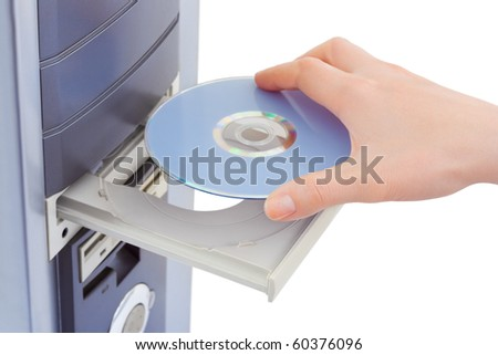 Hand and computer cd-rom isolated on white background - stock photo