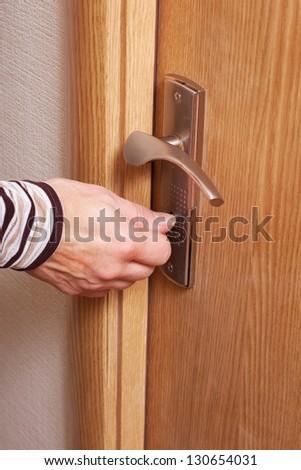 Hand and door. - stock photo