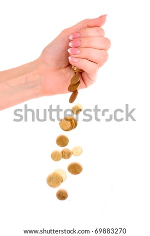 Hand and falling coins isolated on white background - stock photo