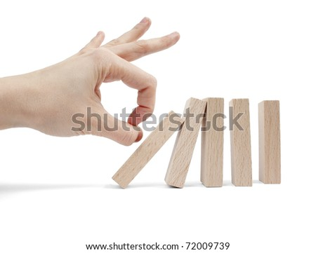 Hand and falling pieces isolated on white background - stock photo