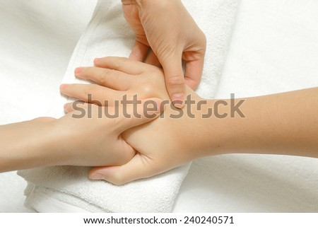 Hand and finger massage in relax spa - stock photo