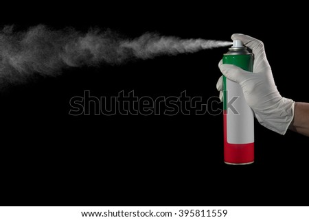 Hand and finger pushing spray can of insecticide - stock photo
