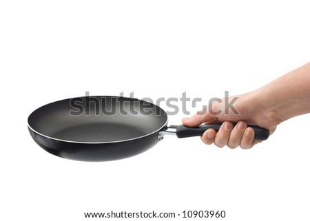 Hand and frying pan, isolated on white background - stock photo