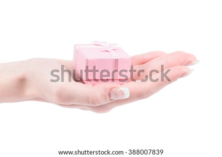 Hand and gift isolated on white background