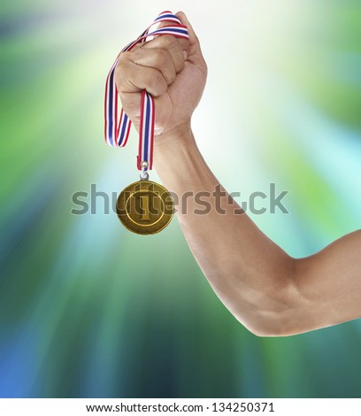 hand and gold medal for multipurpose - stock photo