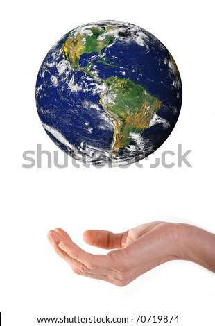 Hand and levitating world over white background. - stock photo
