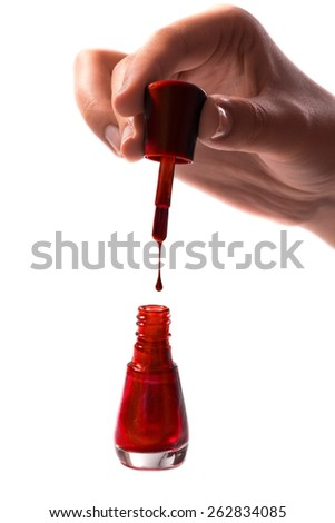 Hand and nail polish on white - stock photo