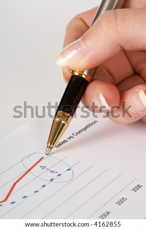 Hand and pen pointing at a diagram