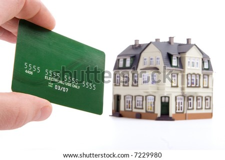 hand and plastic card payment for the house over white background - stock photo