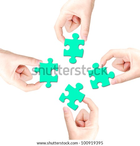 Hand and puzzle - stock photo