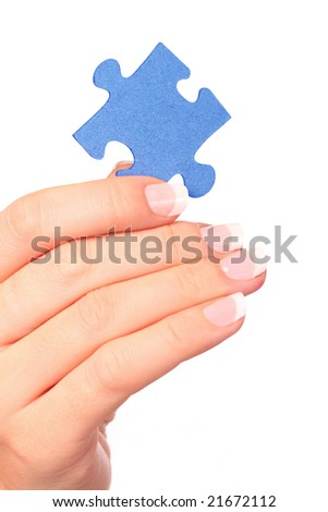 Hand and puzzle, isolated on white background - stock photo