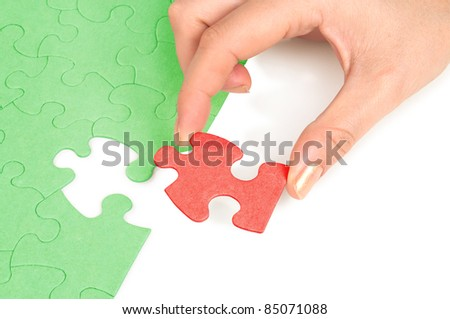 Hand and puzzles isolated on white background - stock photo