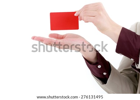 Hand and red card isolated on white