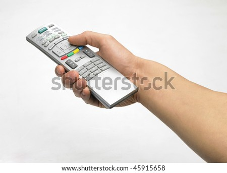 Hand and remote control - stock photo