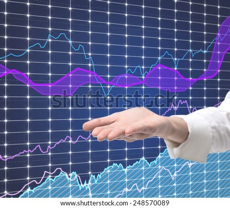 hand and stock graph on virtual screen, close up - stock photo