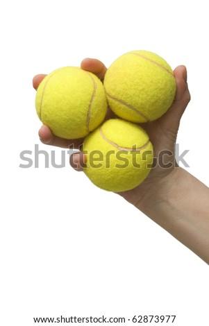 hand and tennis balls - stock photo