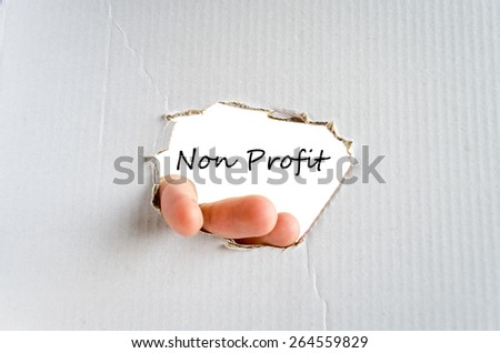 Hand and text Non Profit for text on the cardboard background - business concept - stock photo