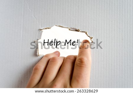 Hand and text on the cardboard background Help me - stock photo