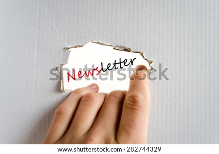 Hand and text on the cardboard background Newsletter - stock photo