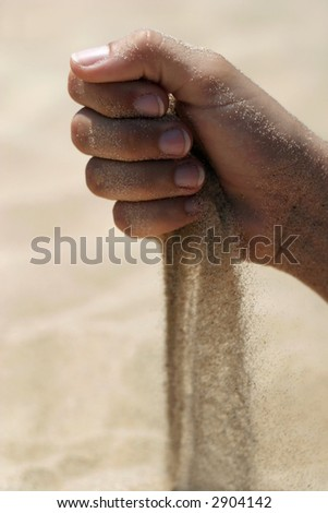 Hand and the running dust - stock photo