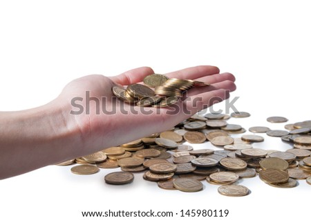 Hand and the scattered coins on the white background