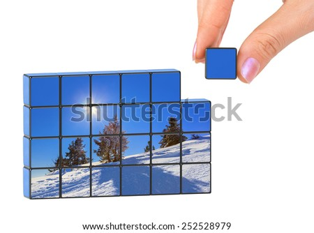 Hand and winter Austria (my photo) puzzle isolated on white background
