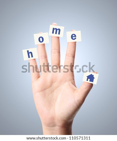 Hand and word Home on white background