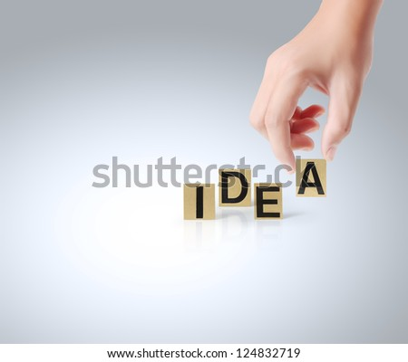 Hand and word Idea on white background - stock photo