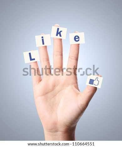Hand and word ike on white background